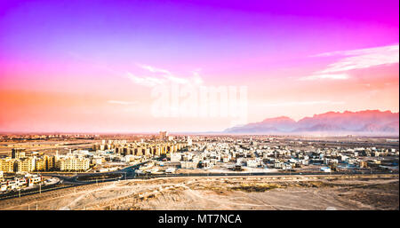 View on purple sunset over cityscape of Yazd in Iran - Stock Photo