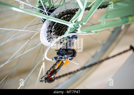 Bicycle rear gear shift mechanism. Closeup of bicycle rear derailleur - Stock Photo