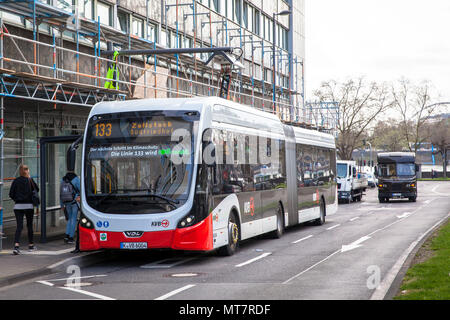 electric bus of the line 133 at a charging station at Breslauer Platz, Cologne, Germany.  Elektrobus der Linie 133 an einer Ladestation am Breslauer P - Stock Photo