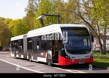electric bus of the line 133 at a charging station at Hoeninger Platz, Cologne, Germany.  Elektrobus der Linie 133 an einer Ladestation am Hoeninger P - Stock Photo
