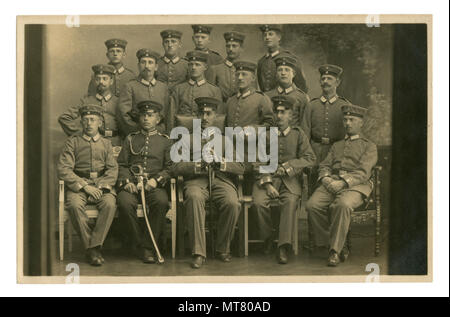 German historical photo: group portrait of a military unit, soldiers and the officer with a saber and second class iron cross ribbon. world war one - Stock Photo