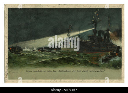 German historical postcard: The Navy lights its way with spotlights in the stormy sea, on a dark night. world war one 1914-1918. Germany. - Stock Photo