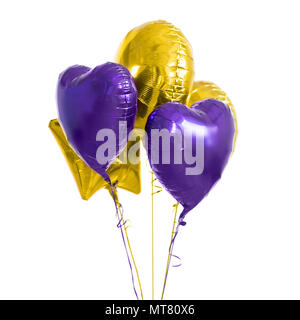close up of helium balloons over white background - Stock Photo