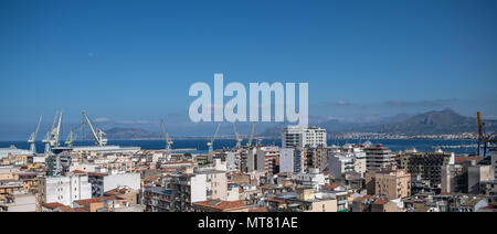 Skyline of Palermo, Sicily, Italy with cranes of the international merchant port - Stock Photo