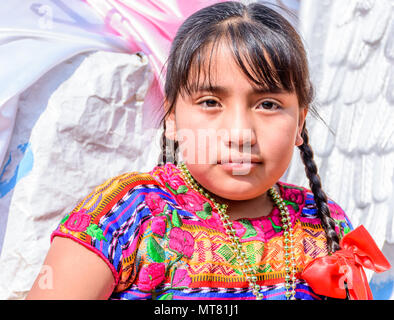 Cuidad Vieja,, Guatemala -  December 7, 2017: Traditionally dressed indigenous girl in parade celebrating Our Lady of the Immaculate Conception Day. - Stock Photo