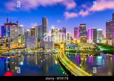 Miami, Florida, USA downtown skyline over Biscayne Bay at night. - Stock Photo