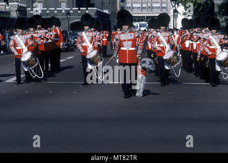 1988 HISTORICAL IRISH FOOT GUARDS MARCHING MILITARY BRASS BAND WITH DOG MASCOT CHANGING THE GUARD THE MALL LONDON ENGLAND UK - Stock Photo