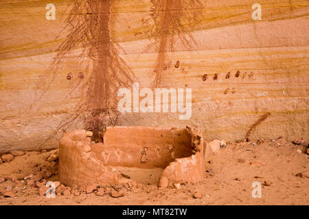 Ancient Ancestral Puebloan historic site structure with pairs of handprint pictographs on the back wall of a cliff dwelling in southeastern Utah, Unit - Stock Photo