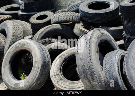 used car tires pile in the tire repair shop yard - Stock Photo