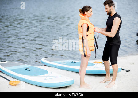 Wearing life vest on the beach - Stock Photo