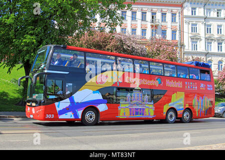 Red double-decker Hop on Hop off sightseeing bus drives along Helsinki street in summer to visit tourist attractions. Helsinki, Finland - May 24, 2018 - Stock Photo