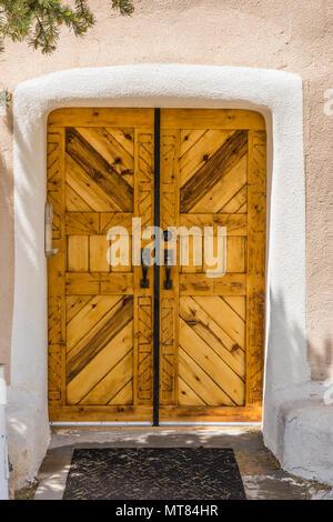 Wooden doors of San Francisco de Asis Catholic Church in Golden, New Mexico - Stock Photo