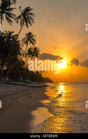 Sunset on the beach of Bang Por on Koh Samui in Thailand - Stock Photo