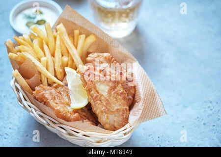 crispy fish and chips basket - Stock Photo