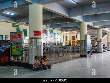 Mandalay, Myanmar - Feb 22, 2016. People at train station in Mandalay, Myanmar. Mandalay is the second-largest city and the last royal capital of Myan - Stock Photo