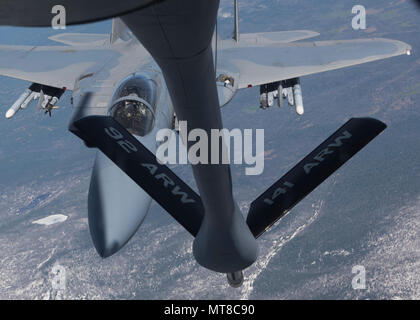 A F-15E Strike Eagle approaches the refueling boom of a KC-135 Stratotanker with the 92nd Air Refueling Wing May 24, 2017, over the state of Washington, USA. The F-15E is a dual-role fighter designed to perform air-to-air and air-to-ground missions. (U.S. Air Force photo by Airman 1st Class Ryan Lackey) - Stock Photo