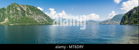 Lake Lugano, Switzerland. Panoramic view of the city of Lugano with, on the left, Mount San Salvatore, and on the right, Mount Bre - Stock Photo