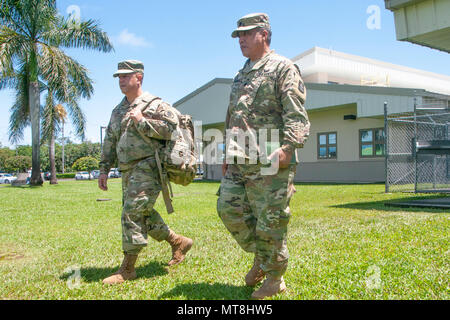 Brig. Gen. Kenneth Hara, Hawaii National Guard Deputy Adjutant General, and Lt. Col. Shawn Tsuha, Task Force Hawaii commander, make their way to the Hawaii County Emergency Operations Center May 14, 2018, at the Joint Operations Center, Hilo, Hawaii. More than 100 guardsmen have been called upon to assist the Hawaii County government in response to an ongoing volcano outbreak. (U.S. Air National Guard photo by Senior Airman John Linzmeier) - Stock Photo