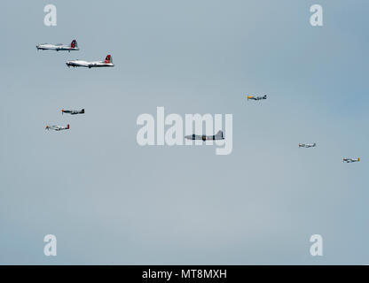 A flight of B-17 Flying Fortresses and P-51 Mustangs flies over Wright-Patterson Air Force Base, Ohio, and the National Museum of the United States Air Force the morning of May 16, 2018. The flight of World War II vintage aircraft was just one of the events marking the opening of the museum's Memphis Belle exhibit. The Memphis Belle is the most famous Flying Fortress, having been the first one able to return to the United States following 25 combat missions over occupied Europe during the war. (U.S. Air Force photo by R.J. Oriez) - Stock Photo