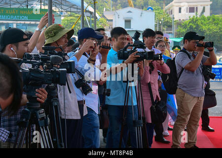 180517-N-QV906-222 NHA TRANG, Vietnam (May 17, 2018) Members of the media gather for a press conference after the opening ceremony for Pacific Partnership 2018 (PP18). PP18's mission is to work collectively with host and partner nations to enhance regional interoperability and disaster response capabilities, increase stability and security in the region, and foster new and enduring friendships across the Indo-Pacific Region. Pacific Partnership, now in its 13th iteration, is the largest annual multinational humanitarian assistance and disaster relief preparedness mission conducted in the Indo- - Stock Photo