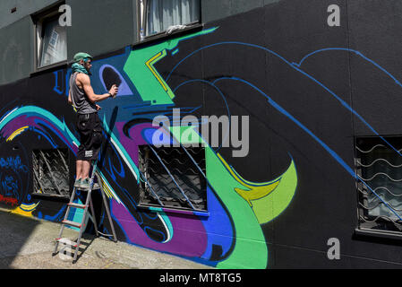 London, UK. 28 May 2018. Street artist Morgandy at work at 'Meeting of Styles' near Brick Lane in East London. The three day festival celebrates street art, with artists from around the world demonstrating their skills. Credit: Stephen Chung / Alamy Live News - Stock Photo