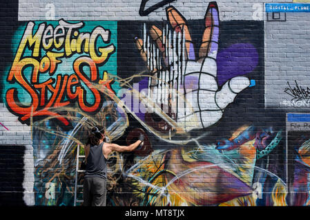 London, UK. 28 May 2018. Street artist Samer at work at 'Meeting of Styles' near Brick Lane in East London. The three day festival celebrates street art, with artists from around the world demonstrating their skills.  Credit: Stephen Chung / Alamy Live News - Stock Photo