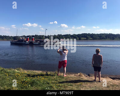 Glasgow, UK. 28th May, 2018. Members of the public take pictures of the PS Waverly as she travels up the River Clyde towards Glasgow, Scotland. PS Waverley is the last seagoing passenger-carrying paddle steamer in the world. Built in 1946, she sailed from Craigendoran on the Firth of Clyde to Arrochar on Loch Long until 1973.   28/5/18  Picture © Andy Buchanan 2018 Credit: Andy Buchanan/Alamy Live News - Stock Photo