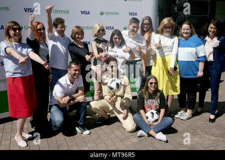 MOSCOW, RUSSIA - MAY 29, 2018: Retired striker Alexander Kerzhakov, actress Irina Gorbacheva (L-R front), and Visa Russia Director General Yekaterina Petelina (4th L back) pose at a ceremony to launch the Football Juggling Challenge, an All-Russian Sberbank and Visa joint flash mob for Visa card owners and users of the special juggling mobile app, the first prize including 2018 FIFA World Cup tickets and admission to an opening training session with football stars. Alexander Shcherbak/TASS - Stock Photo