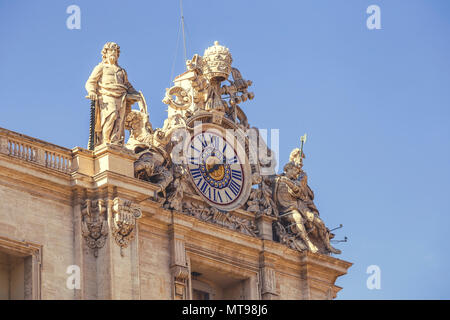 Vatican clock with sculptures on the roof of Basilica of Saint Peter, Vatican City, Vatican. Vintage style. - Stock Photo