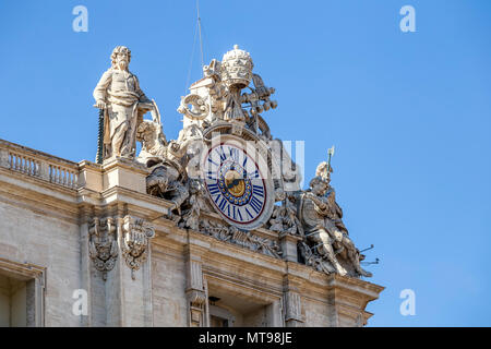 Vatican clock with sculptures on the roof of Basilica of Saint Peter, Vatican City, Vatican. - Stock Photo