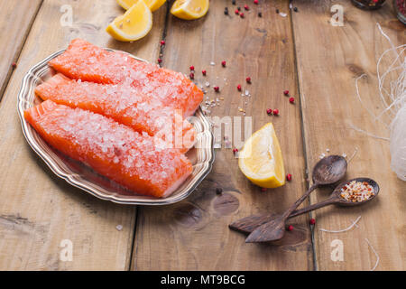 Eastern food. Rice noodles and salmon, lemon and spices. Dietary food. Stil wabi sabi. Healthy food. - Stock Photo