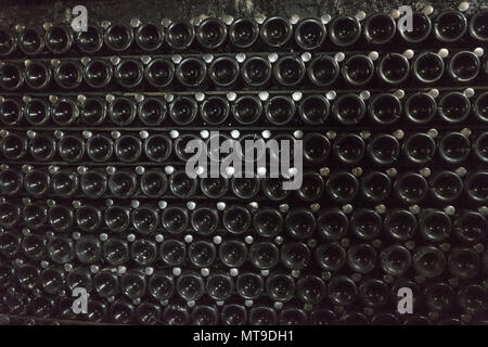 Sparkling wine is aged in bottles - Stock Photo