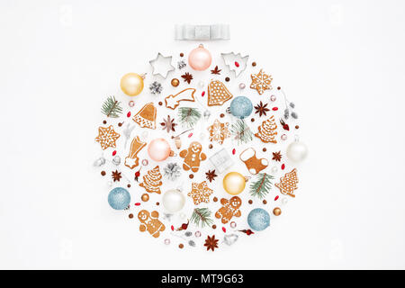 Creative Christmas ball made of gingerbread cookies, balls, pine cones, stars anise, baking molds, acorns, spruce branches on white background. New Ye - Stock Photo