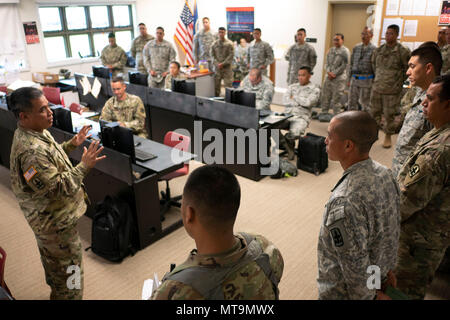 Lt. Col. Shawn Tsuha, Task Force Hawaii commander, addresses his growing team of guardsmen May 16, 2018, at the Joint Operations Center, Hilo, Hawaii. The unit is working alongside with civilian and active duty counterparts under the command of Joint Task Force 5-0 in response to the ongoing volcanic activity on Hawaii Island. (U.S. Air National Guard photo by Senior Airman John Linzmeier) - Stock Photo