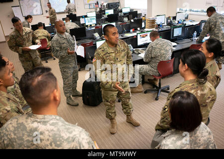 Capt. Aris Banaag, Task Force Hawaii roving security officer-in-charge, trains newly activated guardsmen May 16, 2018, at the Joint Operations Center, Hilo, Hawaii. More than 100 soldiers and airmen have been assigned to Task Force Hawaii, which is assisting government agencies by providing presence patrols in affected and traffic guidance in affected neighborhoods. (U.S. Air National Guard photo by Senior Airman John Linzmeier) - Stock Photo