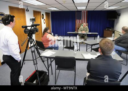 Garrison Commander Col. David J. Pinter Sr. participates in a press conference with local media May 14, 2018, at Fort McCoy, Wis. Pinter became the garrison commander in 2016 and is moving on to a new assignment. Pinter is an Iowa native. (U.S. Army Photo by Scott T. Sturkol, Public Affairs Office, Fort McCoy, Wis.) - Stock Photo