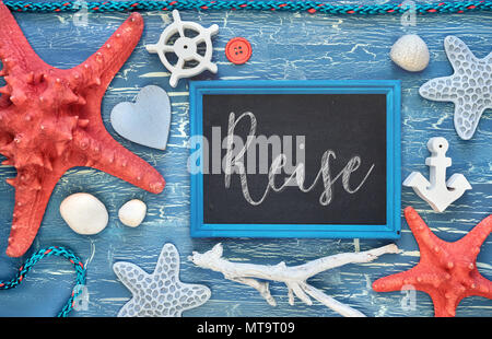 Blackboard With Maritime Decorations on cracked blue wood, text in German. 'Reise' means 'Vacations'. - Stock Photo