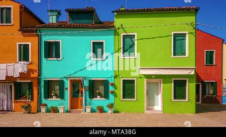 VENICE, ITALY- JUN 20, 2016: Colorful houses in Burano island near Venice, Italy - Stock Photo