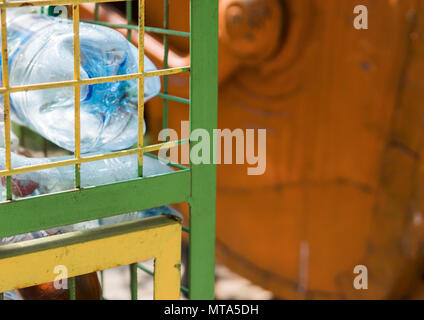 Plastic bottle in the trash. Recycle waste concept. - Stock Photo