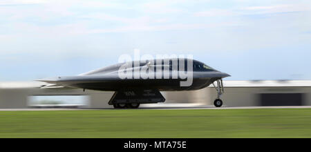 A B-2 Spirit stealth bomber assigned to the 509th and 131st Bomb Wings (BW) races down the flightline during takeoff at Whiteman Air Force Base, Mo., April 20, 2017. The B-2 Spirit is a multi-role bomber capable of delivering both conventional and nuclear munitions. Its low-observable, or 'stealth,' characteristics give it the unique ability to penetrate an enemy's most sophisticated defenses and threaten its most valued, and heavily defended, targets. - Stock Photo