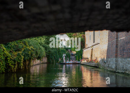 Tourists on a river punt trip on the Great Stour river at Canterbury, Kent, UK. - Stock Photo