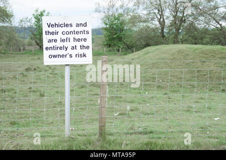 Vehicles and contents left at owners risk sign post responsibility theft loss damage at remote rural countryside national park - Stock Photo