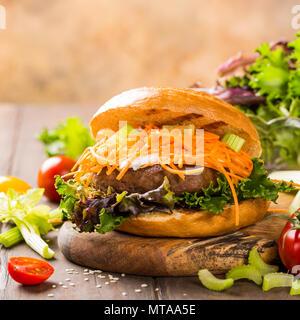 Delicious bagel burger - Stock Photo