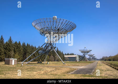 Long row of radio telescopes in westerbork in the Netherlands - Stock Photo