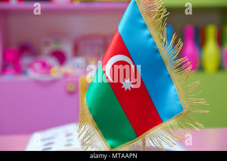 Tooth pick wit a small paper flag of Azerbaijan - Stock Photo