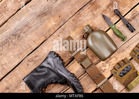 Military equipment with copyspace. Flat lay, top view. Wooden desk surface background. - Stock Photo
