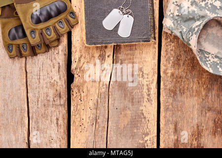 Soldier's belongings with copyspace. Top view, flat lay. Wooden table background. - Stock Photo