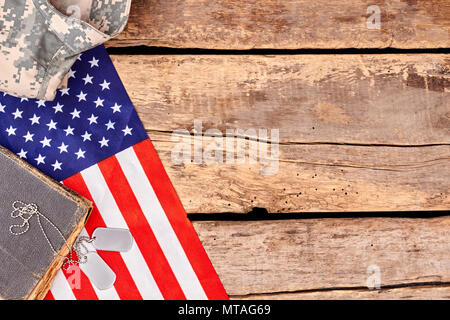US army soldier's accessories with copyspace on wood. Gather of patriotic american soldier's items. - Stock Photo