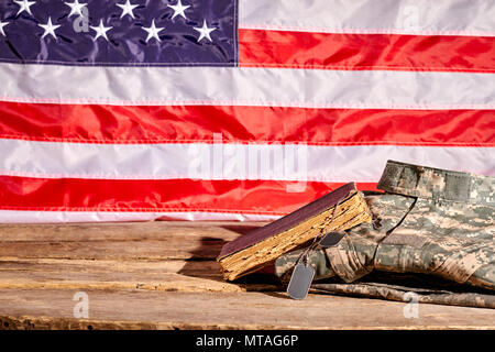 Soldiers accessories in american flag background. Old aged diary book of us soldier. - Stock Photo