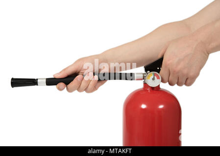 motion hand press the fire extinguisher, isolated - Stock Photo